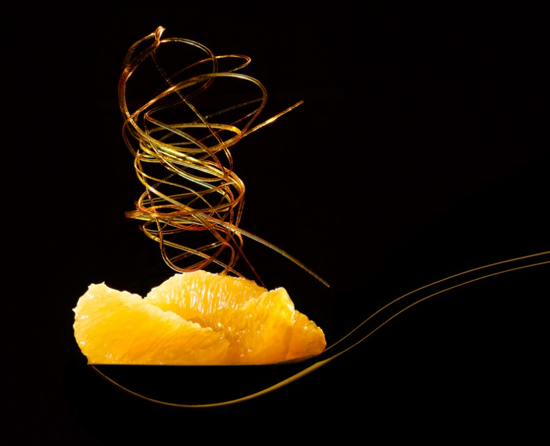 Succulent segments of orange, topped with a tower of spun sugar